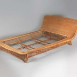 Exceptional rattan bed by Louis Sognot